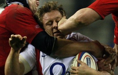 England's Wilkinson is tackled by Wales's Popham and Jones during Six Nations rugby union match at Twickenham in London